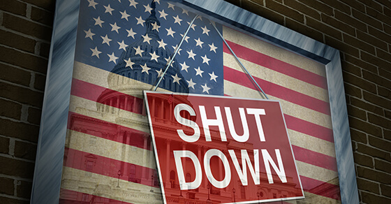 Government Shut Down sign on American flag.